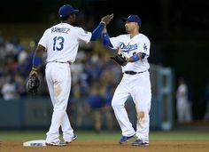 Shane Victorino and Hanley Ramirez celebrate a win over the Rockies August 8th 2012 at Dodger Stadium