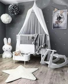 Love the old fashioned bassinet by the crib. Ok for stuffed animals, but much safer for baby in a modern crib. Things were different back then. That could be carried from room to room, baby & all.