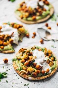 Roasted Veggie Pita with Avocado Dip - spicy roasted cauliflower and chickpeas and creamy avocado dip piled on a super soft whole wheat pita. Yum!