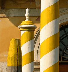 Yellow-Striped Poles in Venezia- I need to find me some yellow ones next time we go!