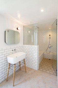 Scandinavian Bathroom With Subway Tiles & Drop in Bathtub
