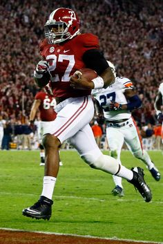 Derrick Henry #27 of the Alabama Crimson Tide scores a 25 yard touchdown in the fourth quarter against the Auburn Tigers during the Iron Bowl at Bryant-Denny Stadium on November 29, 2014 in Tuscaloosa, Alabama.