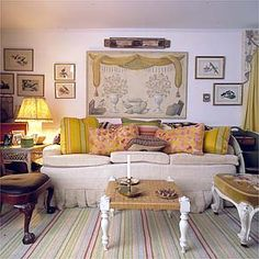 Sister Parish's living room in her summer house in Maine. Pillows