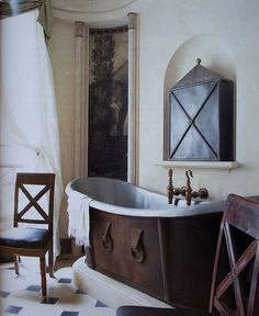 Designed by french interior designer Frédéric Méchiche    -I love this old style bath tub. :)