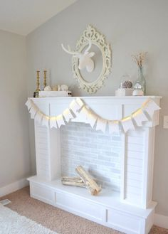Learn how to make your very own Faux Fireplace with a hearth. A great solution for those without a fireplace and a great way to cozy up your home.