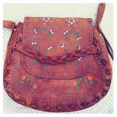 Handstamped and painted leather Hippie boho.  Shoulder length braided strap.  Beautiful carvings & colorings.