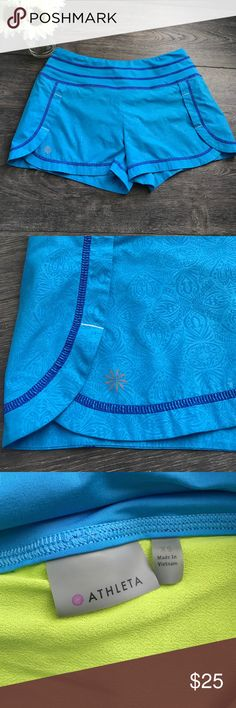 """Athleta Stability Run Short EUC, bright printed blue with purple stitching and neon green liner, infinity drawstring at waist, wide lay-flat style of waistband, slots at sides for mobility, measurements taken laid flat: waist 14"""", hips 17.5"""", length 11"""", inseam 2.5"""" Athleta Shorts"""