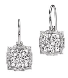 Harry Winston Belle earrings. There is also a pendant and a ring in the same collection. All stunning!