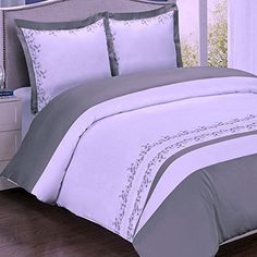 Modern White and Grey Embroidered Floral Pattern 100 percent Egyptian Cotton Duvet Cover and Shams Set.  Bedding set features grey embroidered flowers on white background.  Made of 300 thread count 100% egyptian cotton for softness and comfort.