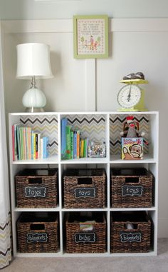 Great way to organize toys -- i have this exact storage cubical.. currently with 6 brown collapsible storage boxes.. =) i love the clean look of this one.. totally going to tweak it a bit and make it our own! =)