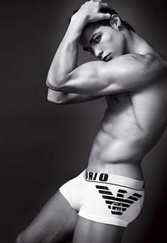 Real Madrid soccer star Cristiano Ronaldo sizzles in a new teaser video ad for Emporio Armani underwear. In the sexy black-and-white commercial, a shirtless, underwear-clad Ronaldo walks in on a startled maid cleaning his hotel room. Cristiano Ronaldo, Ronaldo Soccer, Emporio Armani, Giorgio Armani, Poses Modelo, Ronaldo Real Madrid, Andrew Christian, Athletic Men, Sexy Girl