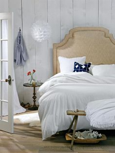 """This breezy, beautiful Mediterranean bedroom was featured in Style at Home as the low counterpart in one of their """"High/low: Can you tell the difference?"""" articles. All it does is make us want to cozy up and forget the cold outside!  (Barrymore custom-fabric 'Palermo' headboard)"""