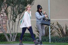 Heather and Naya on set of filming GLEE