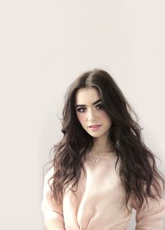 {FC: Lilly Collins} Hello I'm Amanda. I'm 18 and a 6. I work as a bell hop at a hotel. I'm from Midston. I have a older sister named Megan who's married to a 3 from Whites, she practically left our family when she married him. I have depression from everything that goes on and I lack self confidence. I probably won't make a good queen. My mom entered me, I didn't want to do this.