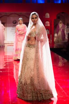 Blush pink and ivory Indian wedding lehenga by Suneet Varma. More here: http://www.indianweddingsite.com/bmw-india-bridal-fashion-week-ibfw-2014-suneet-varma/