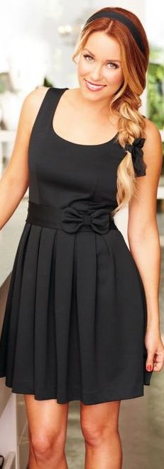 Lauren Conrad - Black dress.  Fitted up top with pleated bottom.  Perfect for larger busted women.