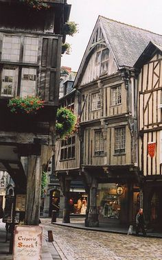 https://flic.kr/p/56GJv1 | Dinan France - Crooked Street | These narrow crooked streets, with buildings that lean and sag in all different directions remind me of Diagon Alley from the Harry Potter movies.