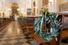 Wedding in Italy love the olive leaf wreaths at every other pew!!