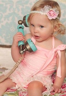 Blonde, headband, wearing pink, and pretending to talk on the phone. Yep, that's just like me when I was little.