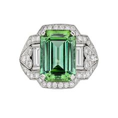 Green Tourmaline and lots of diamonds on a chunky ring setting.