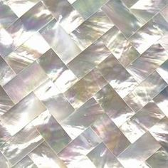 OMG... wait until you see what this mother of pearl tile does when mixed with white carrera marble...to die for!