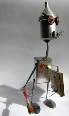 Upcycled Repurposed Recycled robot sculpture - young painter Pablo sing - over the Rainbow. via Etsy.