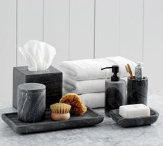 A matching set of marble accessories will make any bath look chic. Fashion designer Monique Lhuillier blends her sophisticated style and her love of celebration in this collection for Pottery Barn, featuring registry favorites for the bath, bedroo…