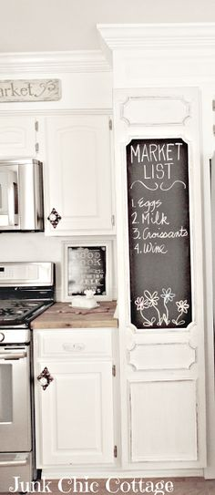 Junk Chic Cottage, Like the white cabinet door w chalkboard paint on it and curved detail edges.