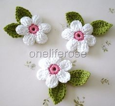 Crochet Flowers This listing you will receives 9 pieces of crochet applique. 3 flowers 4 cm inches) White with … Crochet Leaves, Crochet Motifs, Crochet Flowers, Free Crochet, Crochet Patterns, Yarn Flowers, Crochet Chain, Crochet Mask, Crochet Brooch