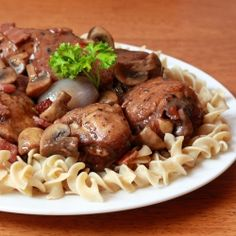 ... braised chicken with mushrooms, onions and bacon in a red wine sauce