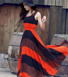 FANTASTIC ON TREND COLOR BLOCKED STRIPES.THERE'S NOTHING AS EASY OR BREEZY AS A MAXI DRESS. WITH DAINTY A FLATTERING EMPIRE WAIST, THIS CHIFFON DRESS INSTANTLY PUTS US IN A VACATION STATE OF MIND.