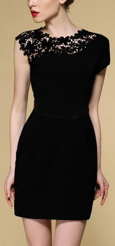 Black dress with a touch of cutenes.