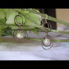 Hand crafted pearl and metal earrings Never worn! Hand crafted at an arts fair in Connecticut, these are delicate and perfect for any outfit. Pair these with a simple necklace and chic scarf for an effortless look! Jewelry Earrings