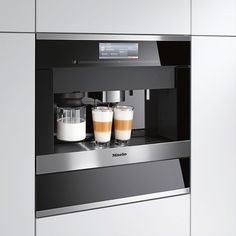 Miele Appliances at London Kitchen Store offer a hard-wearing and versatile addition to any home looking to create a truly stunning kitchen. Miele Coffee Machine, Coffee Maker Machine, Kitchen Appliance Storage, Kitchen Appliances, Machine A Cafe Expresso, Cappuccino Machine, Built In Coffee Maker, Automatic Coffee Machine, Cafetiere