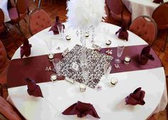 Cute table decor... leaning toward this style but on retangle tables.