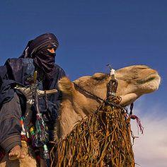 tuareg riding camel...flickr.com