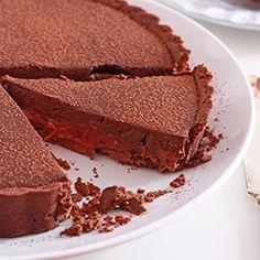 A decadent dark chocolate ganache tart with a layer of tangy roasted rhubarb #foodgawker