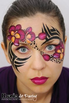Tribal face painting with flowers. Ksenia