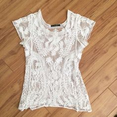 Sheer lace short sleeve top Cool embroidered design. Lightweight slight stretch. Fits size small Tops Tunics