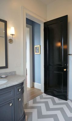 Thinking of staining or painting the doors throughout the house a dark color like this to match the kitchen cabinets.
