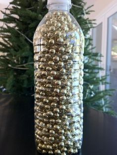And put bead garland in a water bottle to keep it under control. | 15 Crucial Holiday Storage Hacks That Will Make Your Life Easier