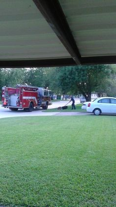 Firefighters Mow Lawn