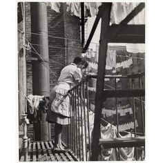 U.S. Young Woman Hanging Laundry on Clothesline (Harlem), 1948 // Gordon Parks