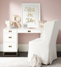 The clean white lines and metallic detail on the Avalon desk ($1,399) make it a winner. Image Source: Res...