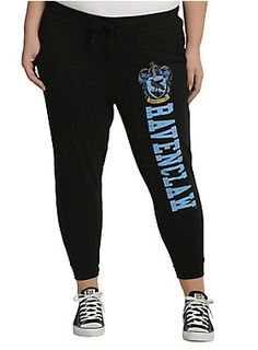 """<div>Snuggle up for a <i>Harry Potter</i> marathon in these super comfy Ravenclaw joggers. The black joggers feature the Ravenclaw house crest and text design down the left leg, elastic drawstring waist, pockets and elastic cuffs.</div><div><ul><li style=""""list-style-position: inside !important; list-style-type: disc !important"""">100% cotton</li><li style=""""list-style-position: inside !important; list-style-type: disc !important"""">Wash cold; dry low</li><li style=""""list-style-position: insi..."""