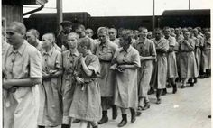 """This here is a picture of Jewish women who's identity was just stripped. They are on their way to the blocks, """"and a life of slave labor."""""""