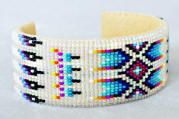Navajo-made Iridescent bone/multi feather/arrow wide cuff