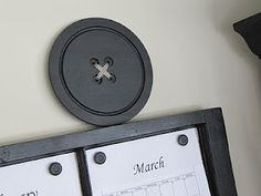 Ok! Button Lovers! You won't believe that THIS huge button above a craft room's wall planning calendar is made with a large cheese board! Click thru and see the 'how to'.