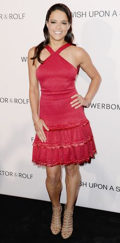 Michelle Rodriguez celebrated the 10th anniversary of Viktor & Rolf's Flowerbomb and joined the design duo on the red carpet in a red-hot halter dress with a tiered hem. Nude cage sandals and a single bangle rounded out her look.