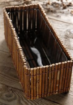Create a nature-soaked herb garden or floral display with this branch-covered box. The planter box features natural wood sticks wired togeth. Tree Branch Crafts, Twig Crafts, Branch Art, Branch Decor, Tree Branches, Wood Crafts, Nature Crafts, Wood Planter Box, Wood Planters